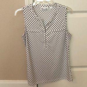 White and black polka dot blouse